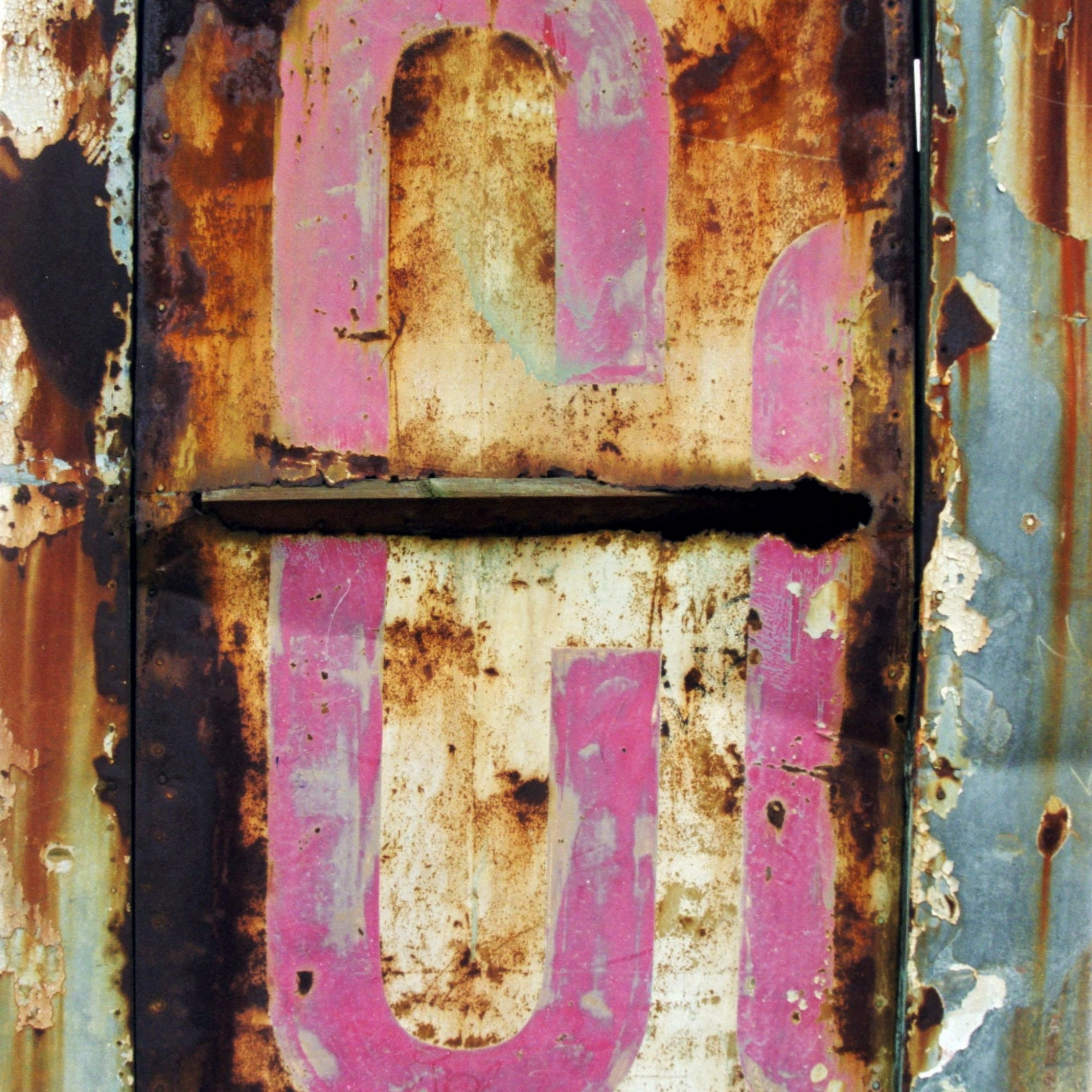 Captured detail of dilapidated vernacular typography