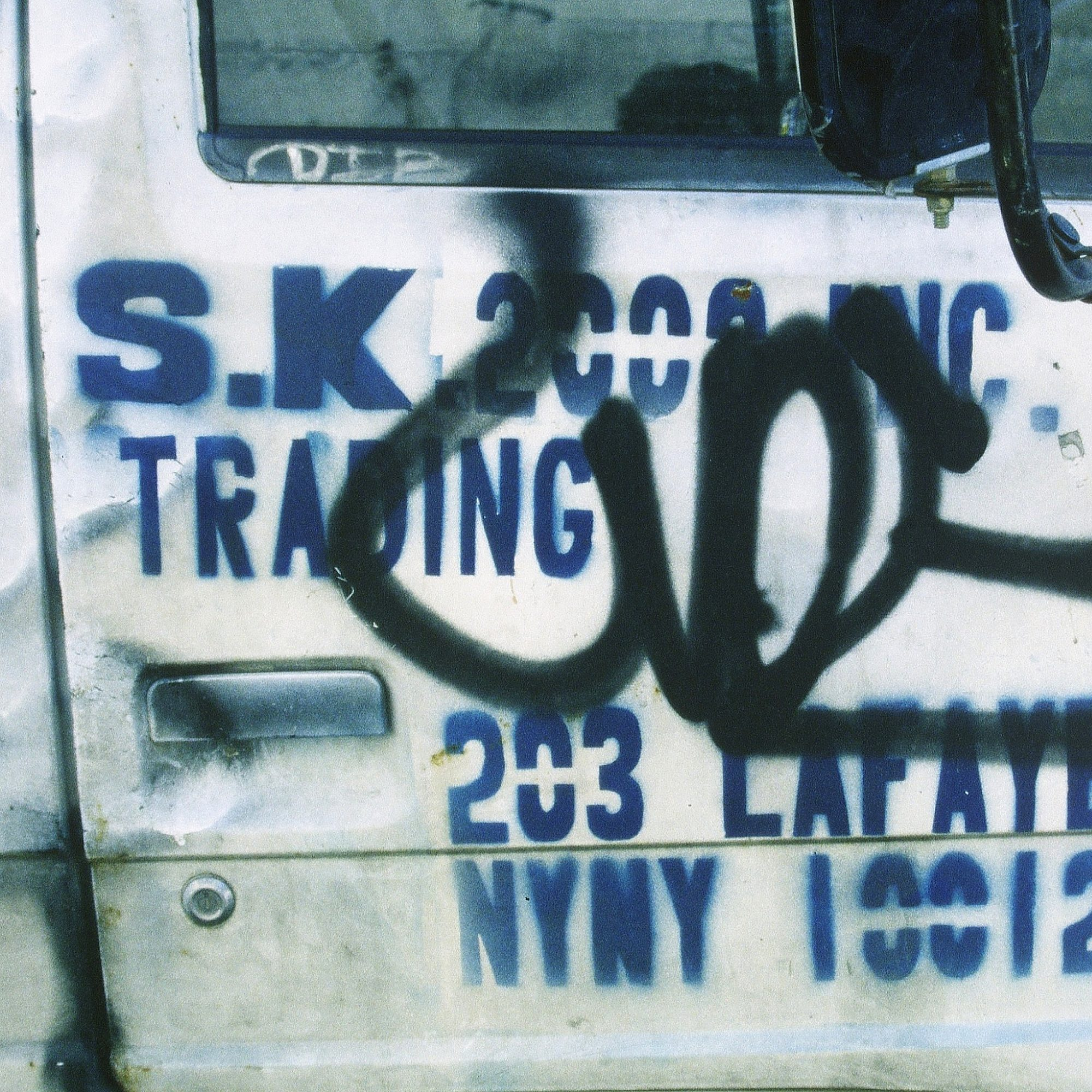 Commercial delivery truck with stencil sign