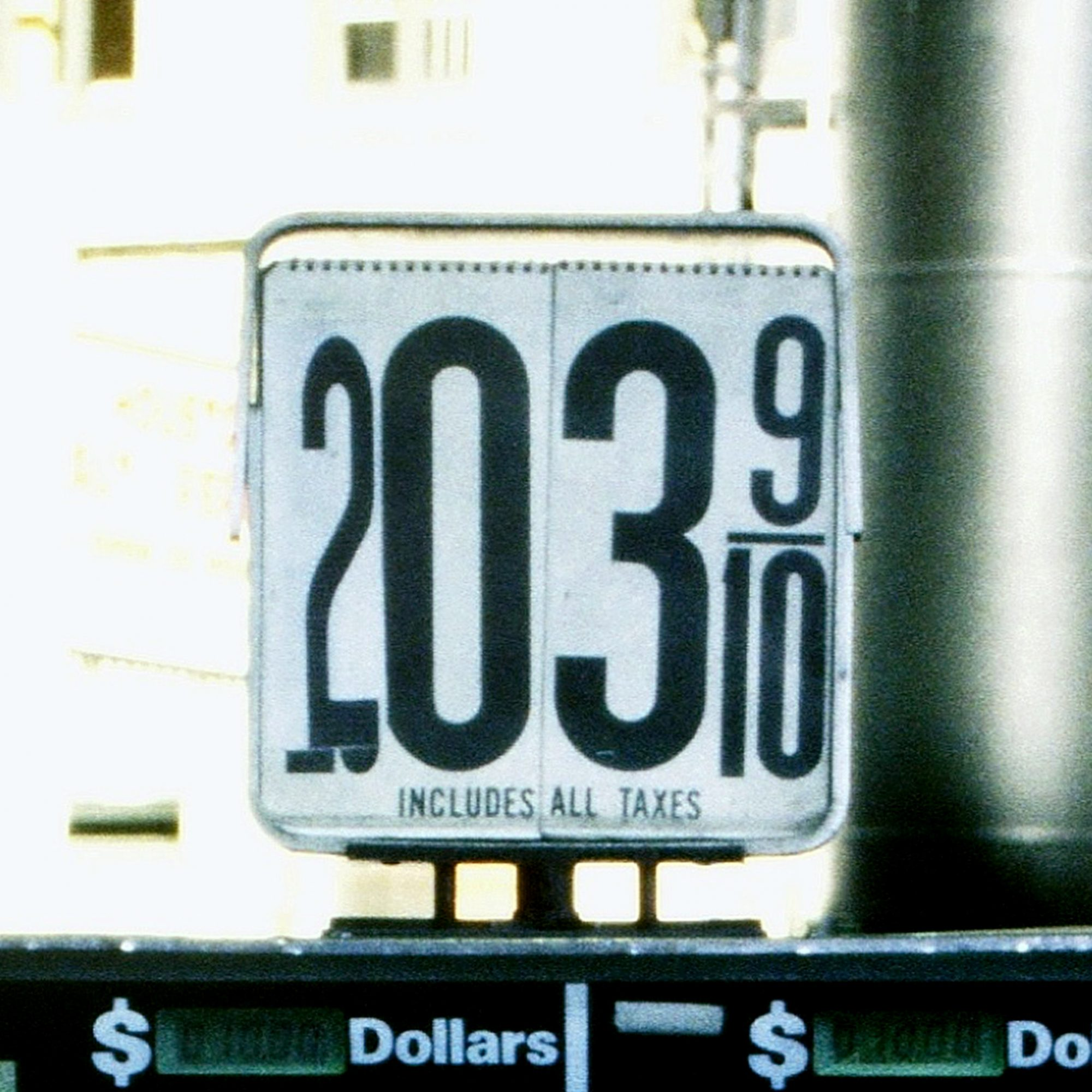 Gas station sign with mismatched price numbers