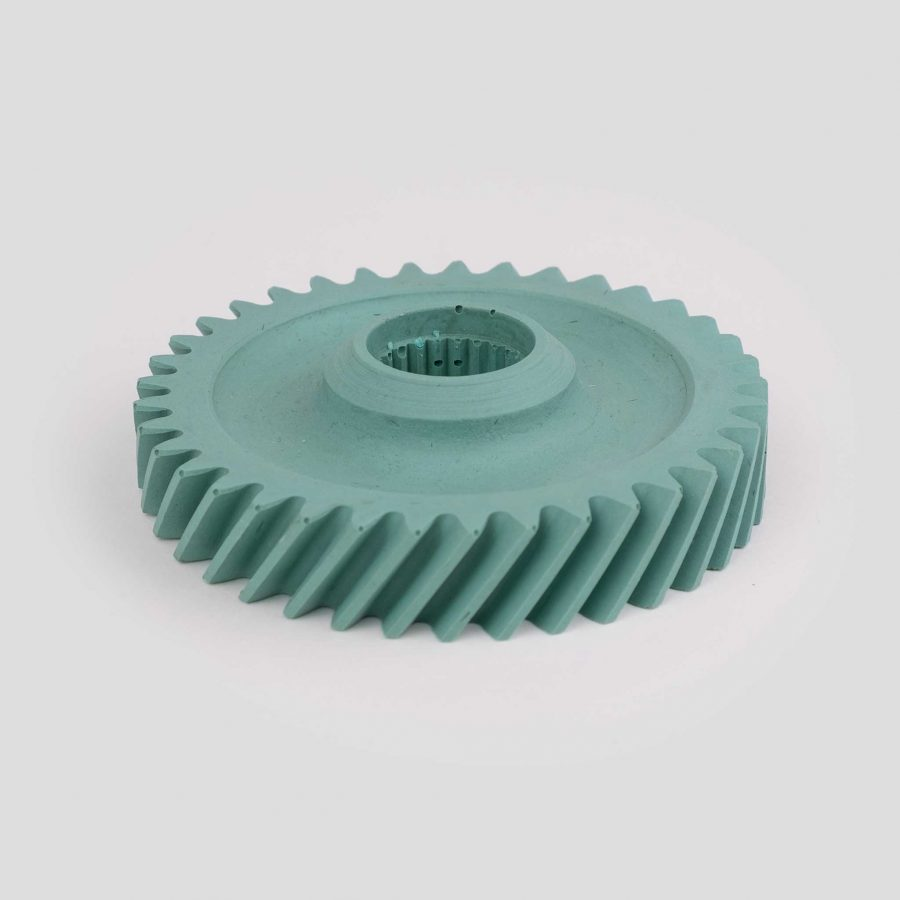 Helical gear candle holder cast in pigment dyed powdered slate